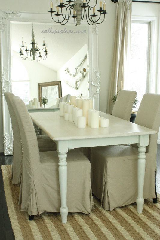 Shabby Chic Dining Room With White Baroque Floor Mirror Farmhouse Table Turned Legs Natural Linen Slipcovered Chairs