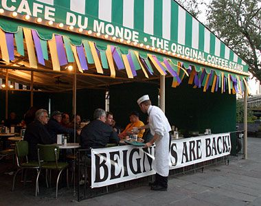 Cafe du Monde (established in 1862) in the French Market, New Orleans, featuring world-famous beignets and coffee.  This was a must-visit location every time we went to New Orleans!  Love those powdery beignets!
