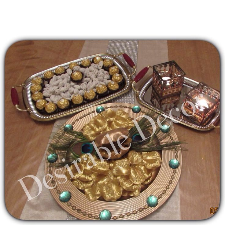 Gold and green peacock themed ring tray.