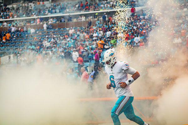 Jay Cutler running through the smoke