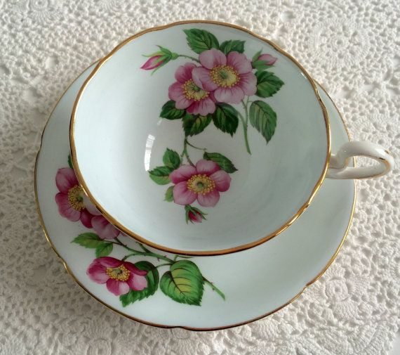 Royal Grafton tea cup and saucer, made in England. A blue ground with pink cherry blossoms on both the cup and saucer. It is in good condition, no chips, cracks or crazing.    Please Note: The items I sell are not new, they are vintage or antiques, it goes without saying that there maybe some imperfections which I will try my best to point out and take pictures of.  I do not look at my items under a microscope, but I do the best I can to describe it.  Please ask questions, what maybe…