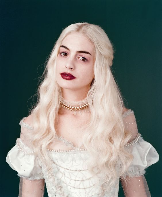 Deep Blood Red Lips and Soft Blonde Waves seen on Anne Hathaway as the White Queen #DisneyAlice