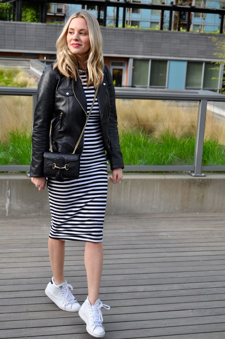 Striped midi dress and leather jacket and sneakers outfit. (Via Confessions of a Product Junkie blog.)