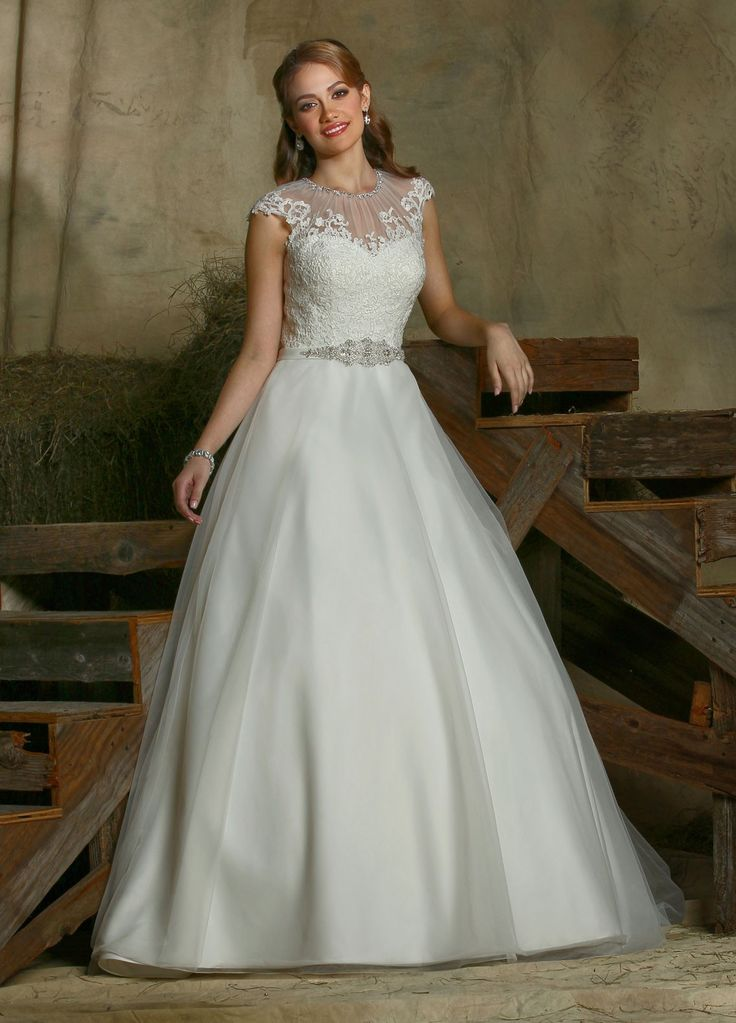 $790 Wedding Dresses, Bridesmaid Dresses, Prom Dresses and Bridal Dresses Davinci Wedding Dresses - Style 50326 [50326] - Davinci Wedding Dresses, Fall 2015. Tulle ball gown features a lace bodice and satin trim at the natural waistline which is accented with intricate beading. Rouched jewel neckline is trimmed with beading. Lace appliques accent the cap sleeves that extend to a high sheer back with button closures. Semi-cathedral train.