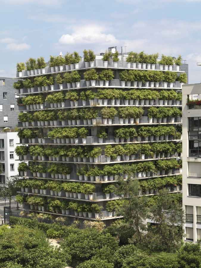 flower tower, paris /// green architecture - - - A box full of ordinary apartments with terraces surrounded by flower pots.  A very literal green building.