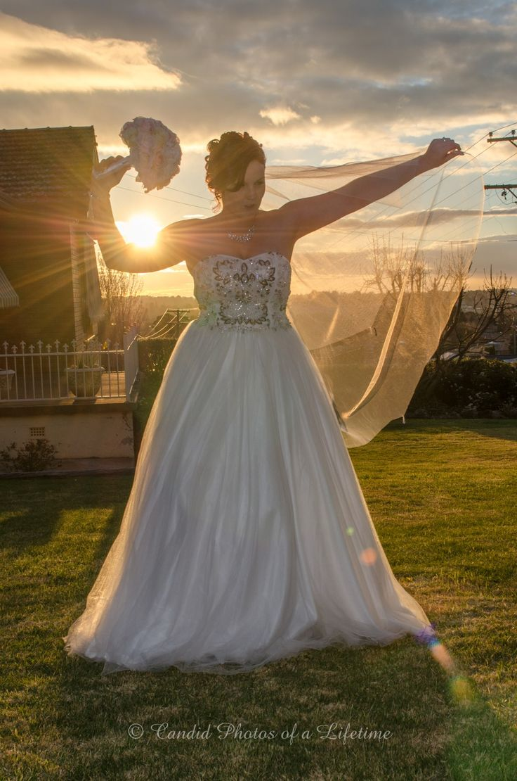 Wedding photographer, Candid Photos of a Lifetime  The bride, and the setting sun