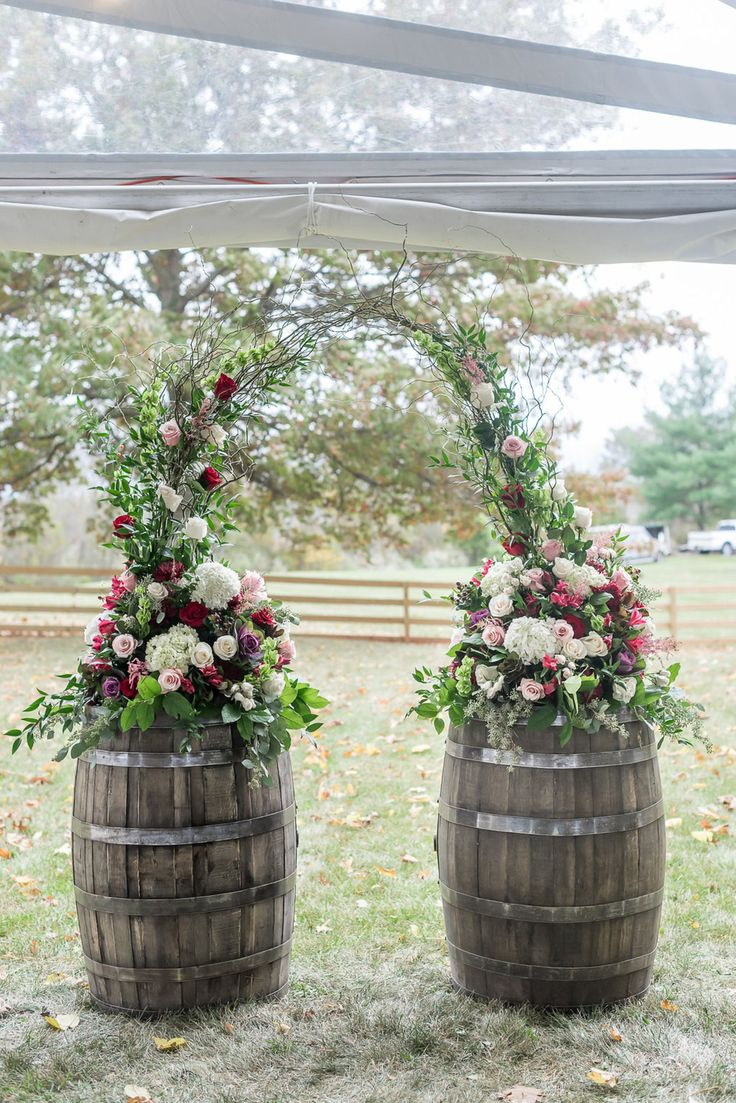 Romantic outdoor wedding ceremony, wedding arbor, barrels, pink and red roses, white florals, branches // Jackie Averill Photography