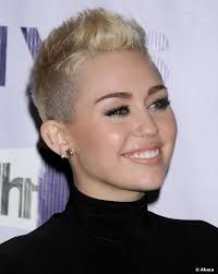 Miley Cyrus' hair looks like a 1990s flat top gone bad.  If you have a ROUND face like HER, please do not attempt this style..ever (unless you wish to remain single for the rest of eternity).