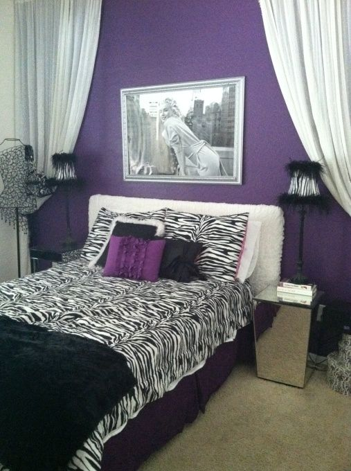 Glam Marilyn Monroe teen purple & zebra bedroom - Marilyn Monroe & Zebra print. Purchased: Paint, black curtain panels, purple bedskirt, white sheets, small canvas picture, purple decor pillow, 2 large & 1 med. size B Marilyn Posters...framed in frames I already owned.  Fuzzy black throw blanket, 2 black vases & 2 deco