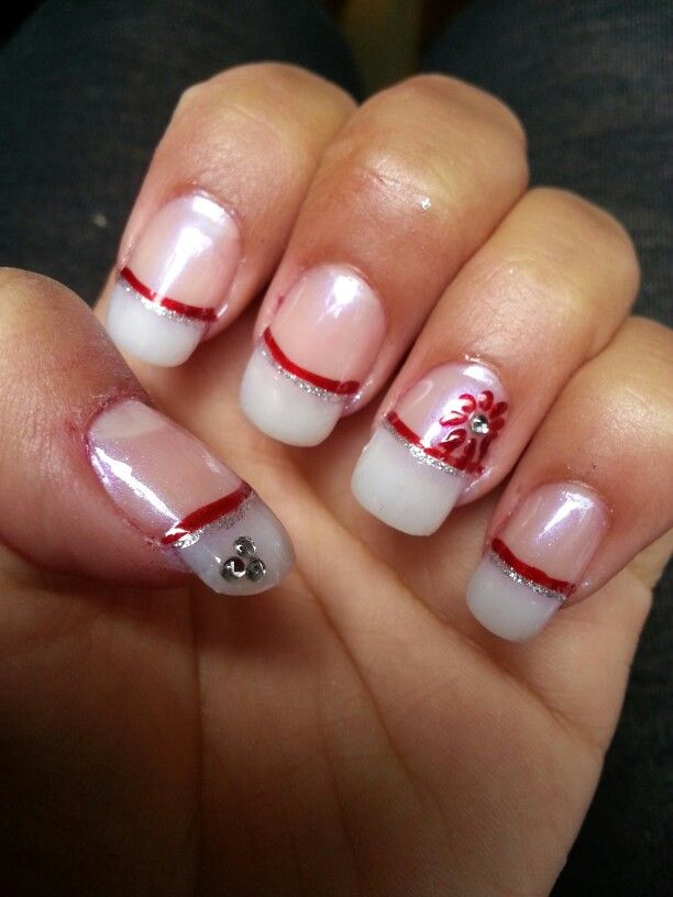 French manicure with red and silver details.