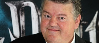 CELEBRITY COLLECTOR - ROBBIE COLTRANE - ART  Robbie Coltrane has been star for years but most people know him as Hagrid from the blockbusters movie series Harry Potter. In Fact Robbie Coltrane, a stand up comedian, has beed in many hit TV shows like the British cult classic 'The Young Ones', TV Series Cracker, Blackadder, The Lenny Henry Show, Minder and many more. Robbie is a big art fan and part of his art collection includes works from Jack Vettriano