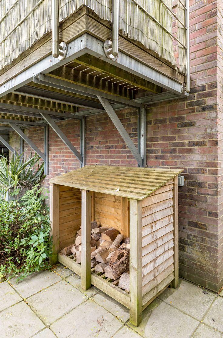 Single storey home flat roof future vertical expansion 6 social side - Modern Terrace Overhang Garden Levels Outside Log Store