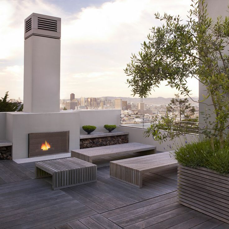 outdoor fireplace, decking, raised planter