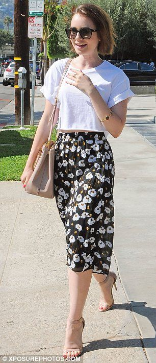 Lily Collins dons flowing floral skirt as she leaves hair salon