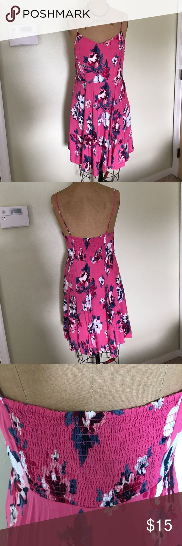 """Old Navy fit and flare cami dress Spring it on! Our fave Fit & Flare Cami dress is back in a big way, just in time for farmers' markets, outdoor cafes and other """"life is good"""" pursuits. Fitted at top and waist, with a flared skirt.  Dress hits above knee. Adjustable spaghetti straps. V-neck. Fit & Flare silhouette has a fitted bodice, defined waist and flared skirt. Soft. drapey rayon poplin. Old Navy Dresses"""