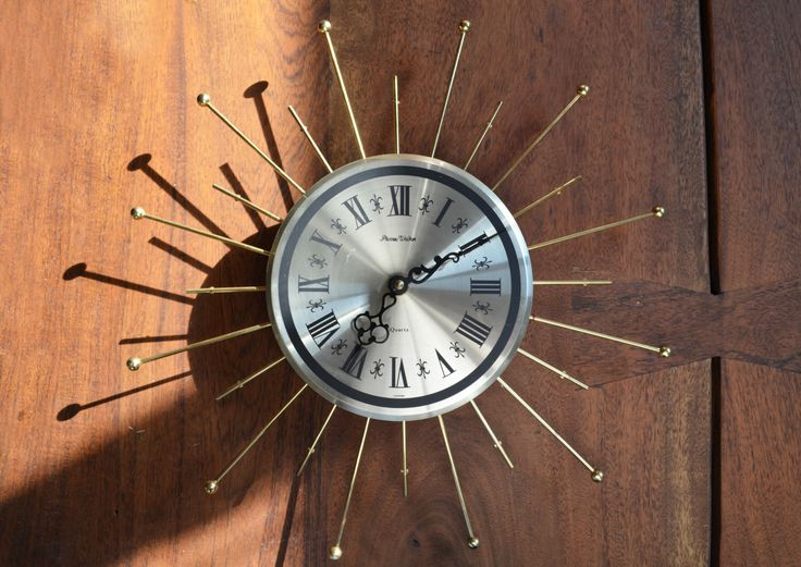 Mid Century Modern Starburst Clock; Phinney Walker Wall / Electric Clock - Vintage Battery Operated, works beautifully by Trashtiques on Etsy https://www.etsy.com/ca/listing/397877877/mid-century-modern-starburst-clock
