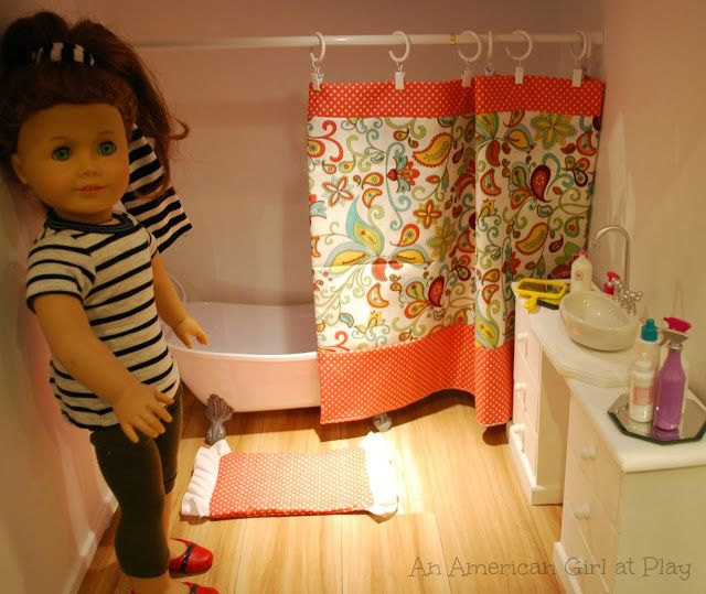 An American Girl at Play -- make a shower curtain out of a tension rod and rings.  Room 24 X 20