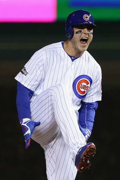 Anthony Rizzo #44 of the Chicago Cubs celebrates after hitting a double in the first inning against the Los Angeles Dodgers during game six of the National League Championship Series at Wrigley Field on October 22, 2016 in Chicago, Illinois.