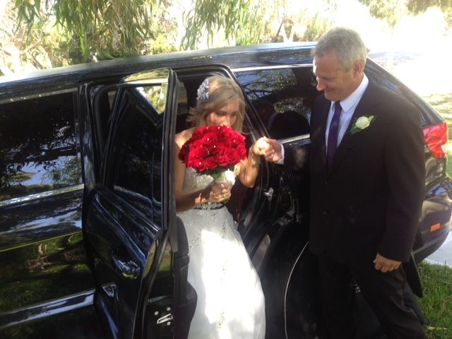 Beautiful Bride stepping out of our Metallic Black Grand Cherokee Jeep. Bellagio Limousines. Limo Hire Perth 9240 6969. http://www.bellagiolimousines.com.au/