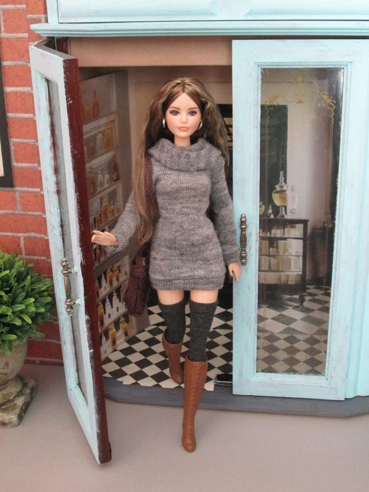 That's what her box says. I don't know what the number symbol represents. She has the Made To Move knees. Her feet are regular Barbie feet and her arms are bendable fashionistas. I love her face! She is wearing panties! Made of the same fabric as her stockings.