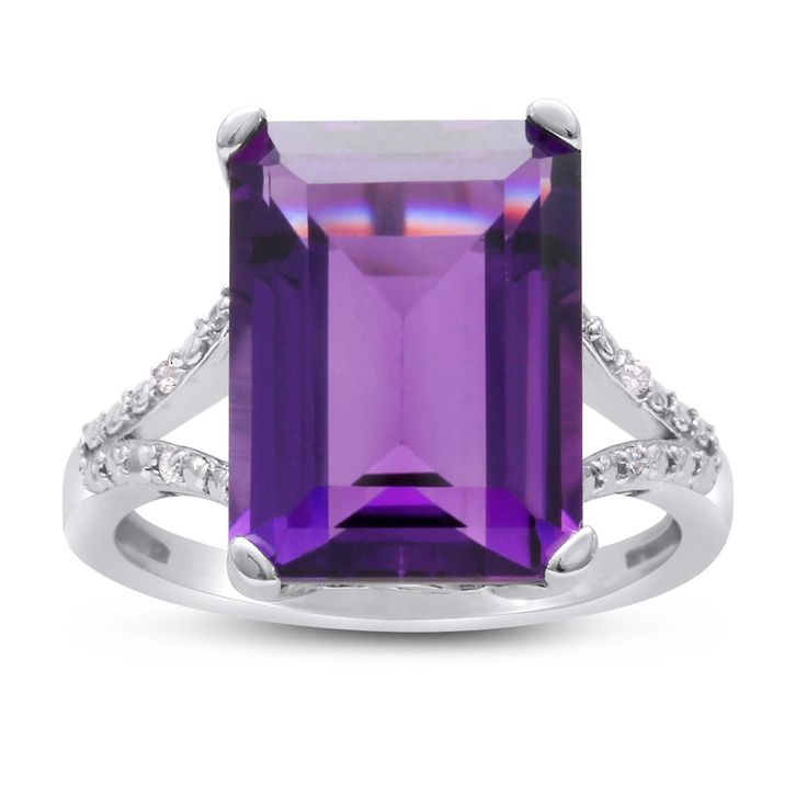 This huge 10ct emerald shape amethyst and diamond ring in sterling silver features an enormous amethyst accented by diamonds in J-K color and I1-I2 clarity. This ring is especially unique because it features a split shank on the band.