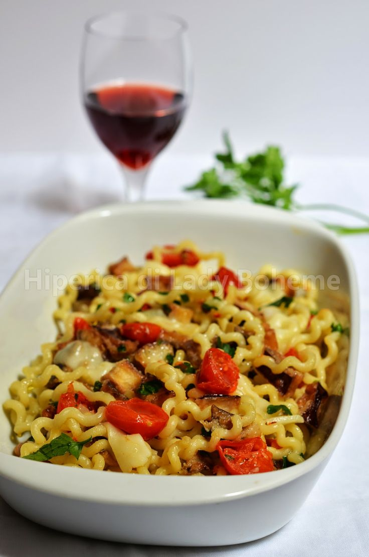 ITALIAN FOOD - FUSILLI CON MELANZANE E POMODORINI - (Fusilli pasta with eggplant and cherry tomatoes).