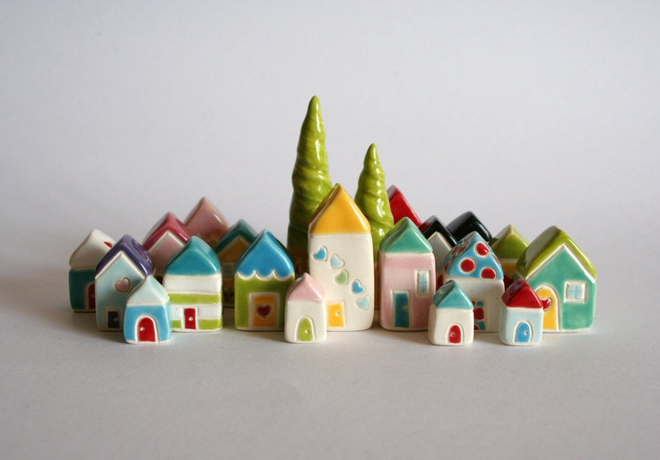 What house doesn't need a collection of teeny tiny houses to occupy shelves?  From Esty!