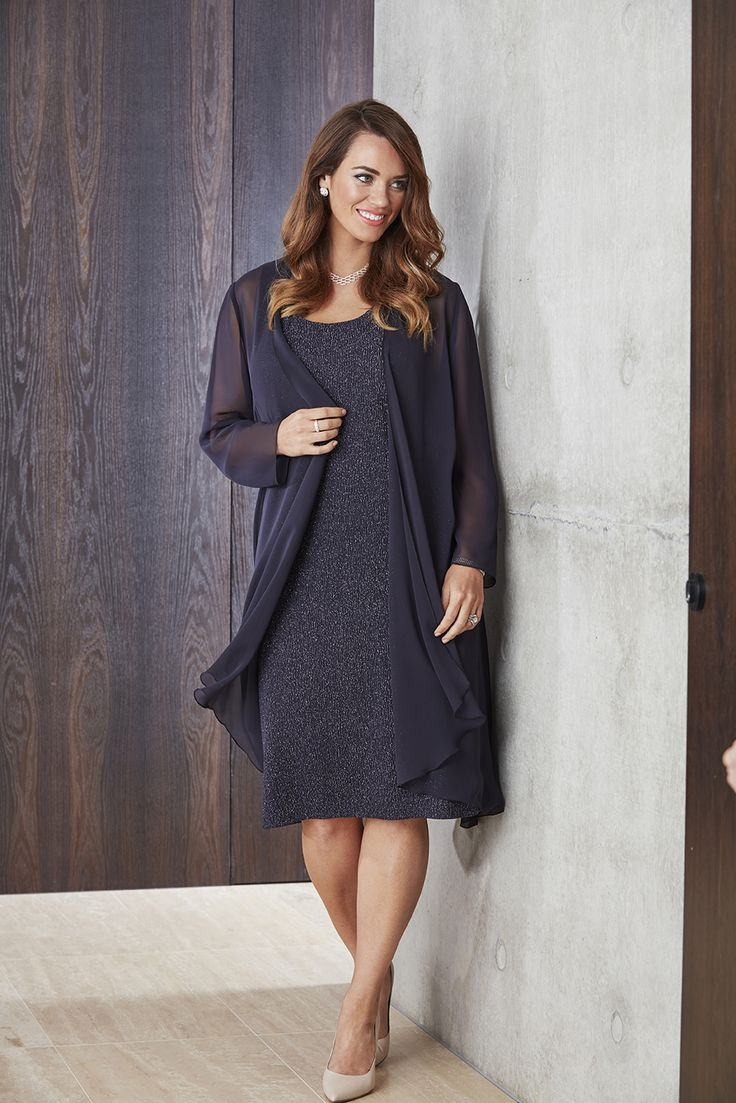 Sizes: 14-24 Galaxy coloured short stretch glitter dress with chiffon jacket by Eve Hunter. This dress is perfect for any formal, cocktail or special occasion for the fuller figure.    Click here to find your nearest stockist
