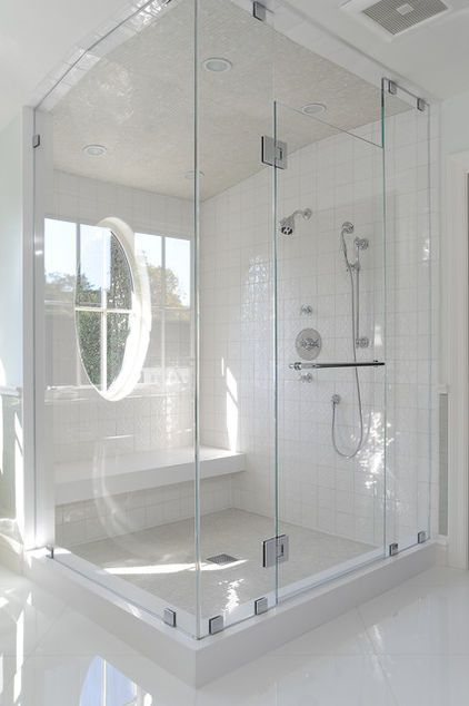 This is so chic, clean, and makes me want to take a shower. I love the frameless shower paired with all white.