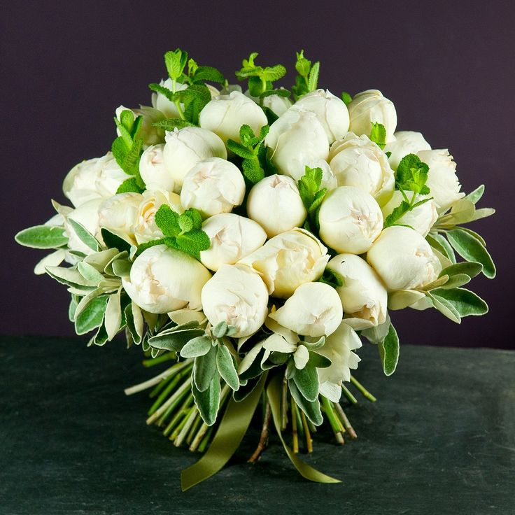 Beautiful Scented Cream Piaget roses, hand tied with seasonal herbs and foliage all grown on our very own farms. A real treat for someone who deserves this special scented gesture even if that someone is you!  For added decadence, select for this bouquet to arrive in one of our beautiful hat boxes from our luxury gifts collection. The Hat Box will make a wonderful keepsake after the flowers have faded. Chocolates and Nyetimber English Sparkling Wine can also be selected from our luxury...
