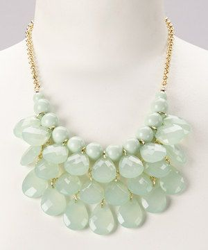 This glossy baubled bib features glistening tiers of softly hued teardrop beads that add a high-drama look to any outfit.