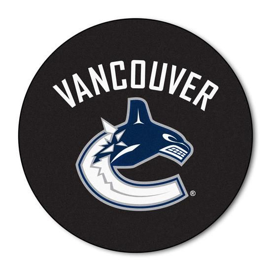 Vancouver Canucks puck shaped floor mat