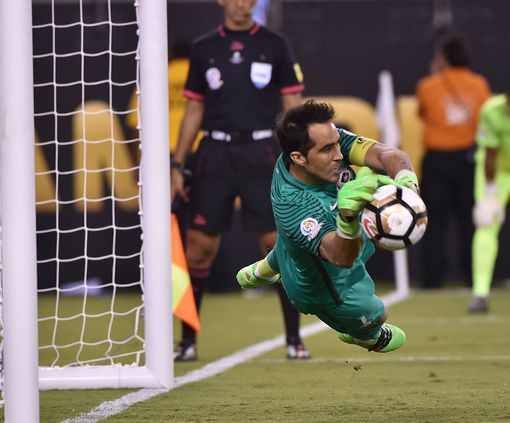 Chile's goalie Claudio Bravo saves a penalty by Argentina's Lucas Biglia