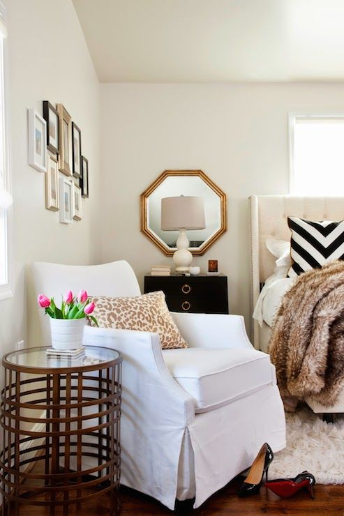 Animal print throws and lush throws give this bedroom hints of #glam.