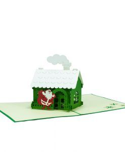 The Happy Christmas House 2 pop up card has a classic Christmas-green cover that features a warm house on Christmas night. The image hints just enough at the amazing surprise inside. Inside the card is a joyful Santa visiting a warm house with its roof covered in snow. We always leave the card blank so that you can personalize your own words.