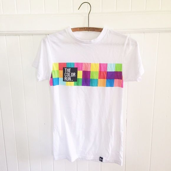 """Sale   Color Run Soft T-shirt Color Run cotton t-shirt. Soft & comfy material. I picked this up at the color run in Kailua Kona, Hawaii  It is in good pre-loved condition with one small paint stain on front (pictured). Cute """"happy"""" detail on left sleeve. Fits XS well, can also work for a small if you are going for a more fitted look. 60% cotton 40% polyester. Tops Tees - Short Sleeve"""