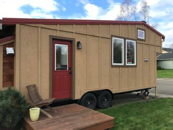 "SUMMARY: Roomy 243 square foot tiny house built to residential standards with sleeping loft, full bath, full kitchen, living area, work space and plenty of storage including a micro ""garage."" Propane instant water heater and cooking. Convection heat and standard plumbing. TRAILER: Iron Eagle trailer designed specifically for a tiny house. 14,000 GVWR double axle, 24' x 8'6""."