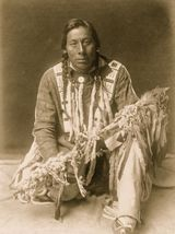 Discover the Ancient Healing Traditions of Native Americans: Native American Shaman with Pipe