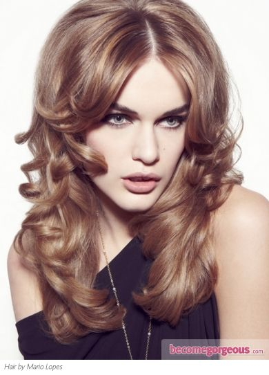 Party Perfect Loose Curls Hairstyle  Long Hairstyles pictures  This party perfect loose curls hairstyle is a top option to honor special events. Perk up your tresses with hot rollers and a spritz of shine spray. Go for a mid part to add a retro flair to your look.