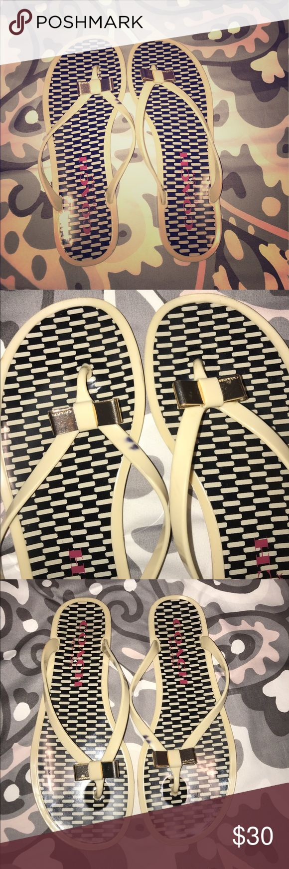 Authentic coach flip flops Used but great condition (one spot on strap -see pic) women's sz. 9 authentic coach cream with gold bow flip flops. Contact me first to make sure still available. Coach Shoes Sandals
