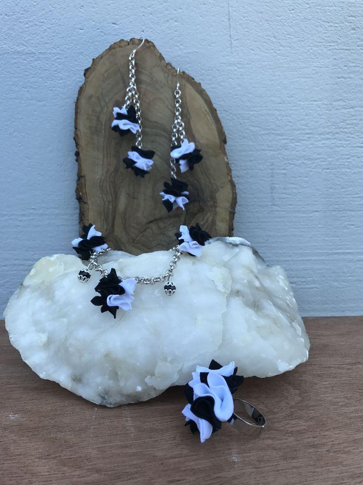 Parure color bianco nero ispirata a Coco Chanel, elegante e sobria.