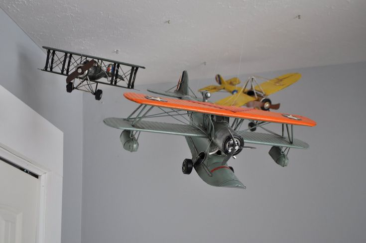 Hang An airplane from the roof in a boys room for vintage feel!
