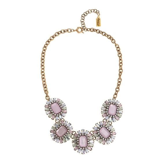 Feminine and pretty, this beautiful pastel coloured statement necklace is the perfect compliment to a Summer wardrobe. Part of our new Luxe collection, a range of high quality statement costume jewellery, the Venus necklace features five side by side clusters of pastel pink, white and clear resin and crystals set on an 18 kt gold plated chain necklace. All of the pieces from the Luxe collection, embody the same style ethos and quality as the mainline Anna Lou of London range but with an…