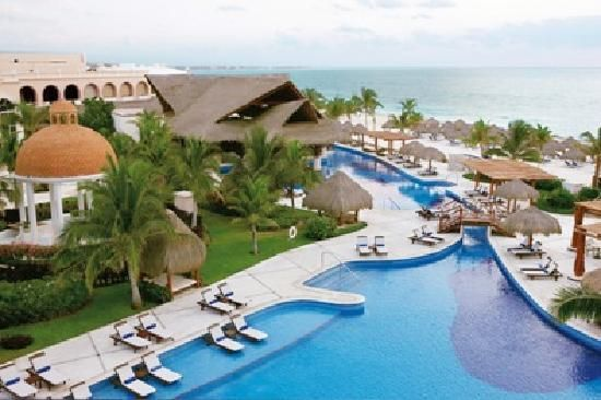 Excellence Riviera Cancun.  All Inclusive. #1 hotel in Puerto Morelos. My favorite in Cancun area.  Beautiful all-inclusive with great food, drinks and service.  Highly recommend!