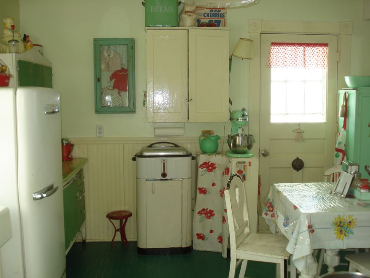 Vintage farmhouse kitchen.  Love the pale greens ! grew up with the Westinghouse roaster all our turkeys were cooked in it