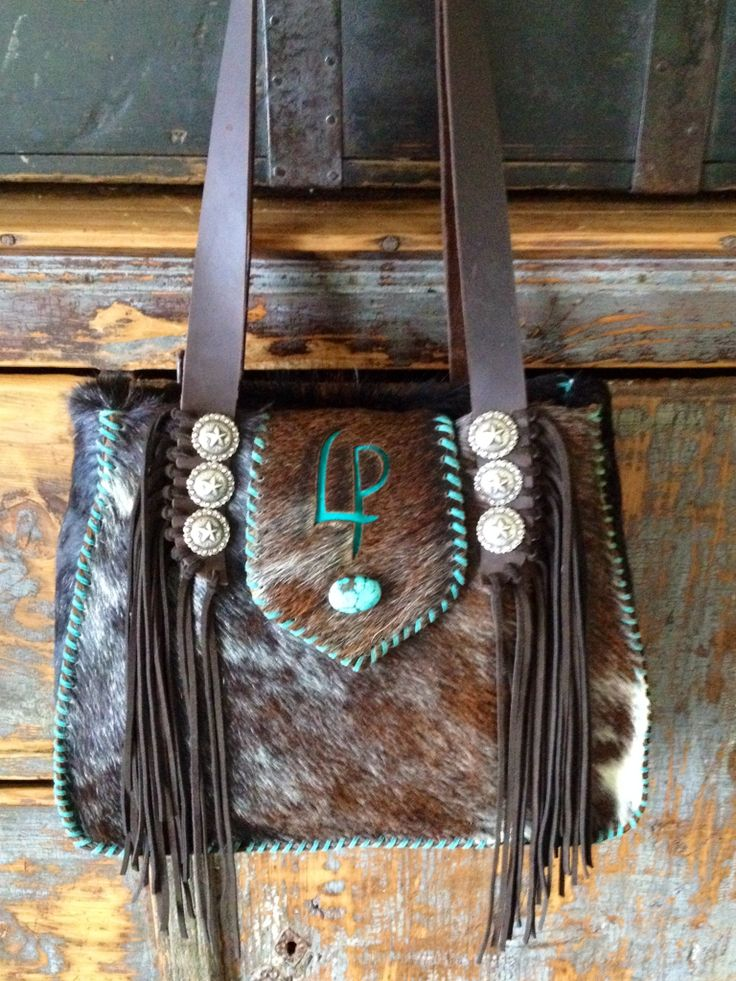Bonnie Bag with turquoise suede stitching and initials. Custom cowhide purses from gowestdesigns.us