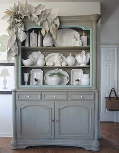 Find a hutch and paint for the front room. Looks like ASCP Provence and French Linen.