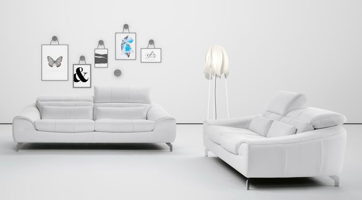 White leather sofa set made in Italy. The sophisticated leather sofa set is sure to make your living or family room more comfortable and appealing. The detail on the feet of this leather sofa, chair, and loveseat will only add to your love for this sofa set. The kiln-dried hardwood frame is built fo...