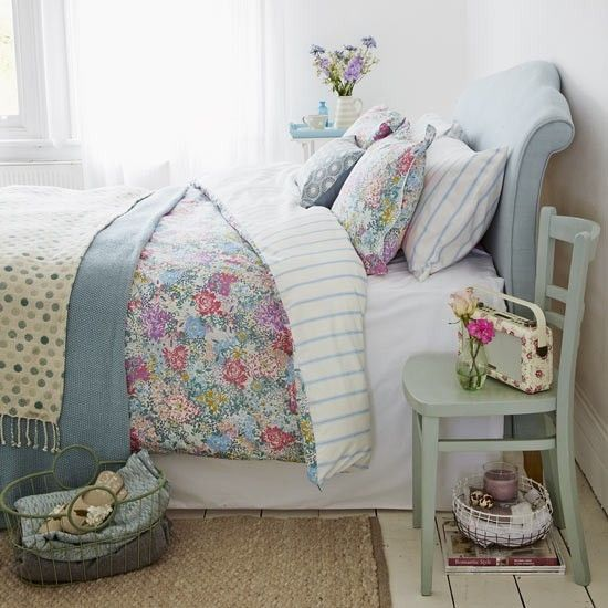 Relaxed bedroom with country florals and shades of blue