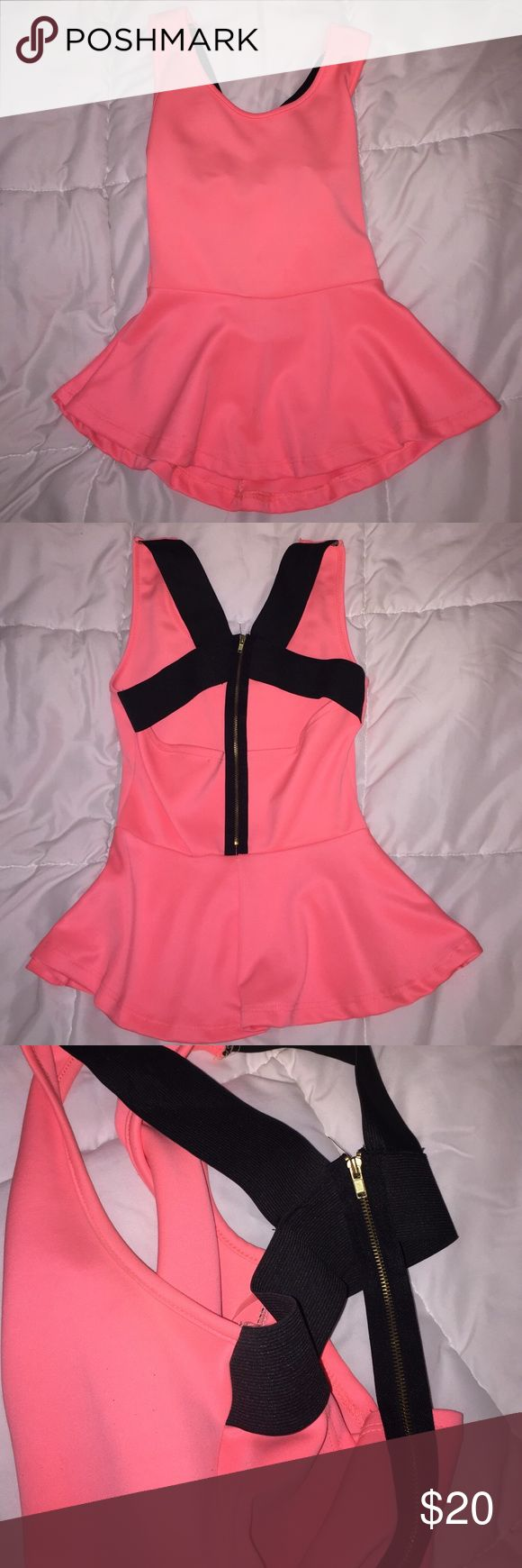 Open back peplum blouse This hot pink peplum top has a strappy open back. It fits wonderfully as it hugs and is loose in just the right places. Tops Blouses